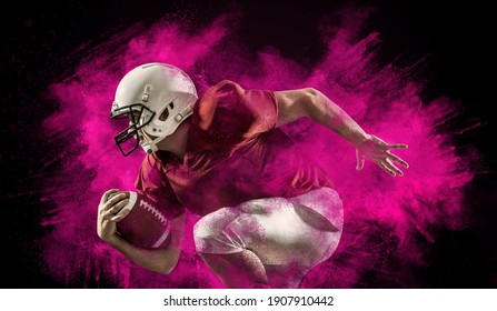 American football sportsman player with ball in action on black background around splash drops. Sport, proud footballer in white helmet and red t-shirt ready to play.