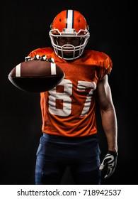 American football sportsman player on black background
