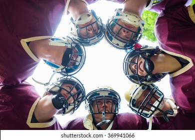 American Football Team having huddle in match