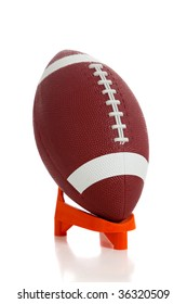 An American football and tee on white background