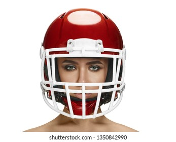 American football theme. Young beautiful woman in helmet isolated on white. Skin protection concept