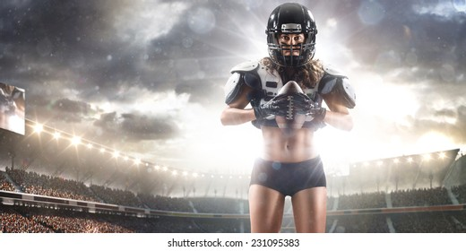 American football woman player holding ball on the stadium Panorama view