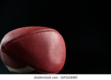 American foottball ball on dark background close up. American football concept