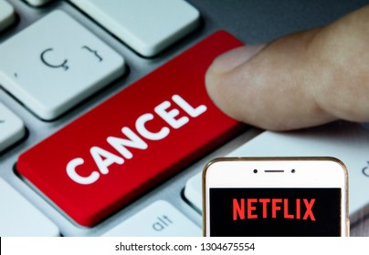 American global on-demand Internet streaming media provider Netflix logo is seen on an Android mobile device with a computer key which says cancel.