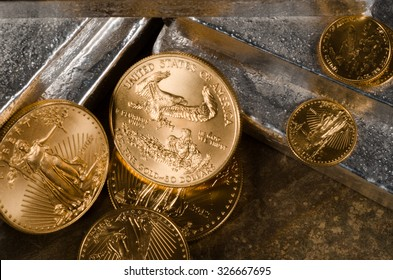 American Gold Eagle Coins with laying on Silver bars