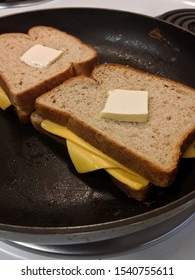 American Grilled Cheese With Sliced Butter In Frying Pan