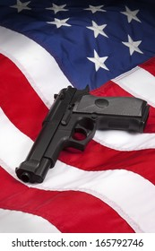 American Gun Law - Hand Gun on the flag of the United States of America.