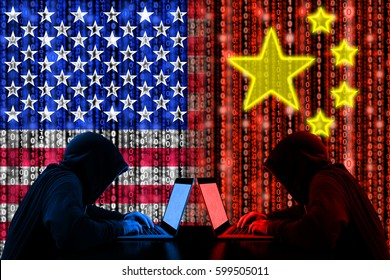 American hacker sitting opposite of a chinese hacker cyberwar concept in front of binary flags