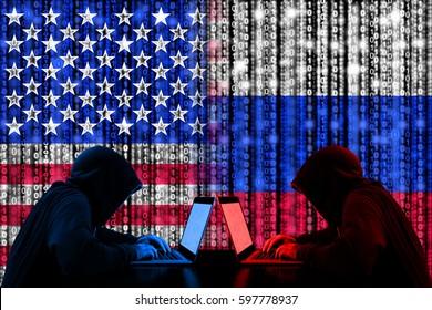 American hacker sitting opposite of a russian hacker cyberwar concept in front of binary flags