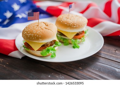 American hamburger or cheeseburger with america flag for USA 4th of July independence day food background concept