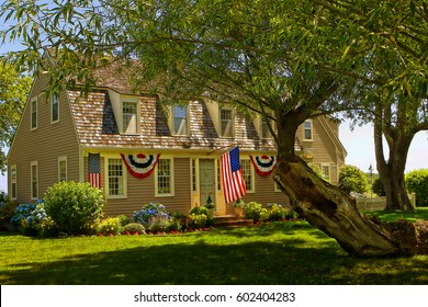 American Home - Decorated in Patriotic Celebration - Independence Day. Cape Cod. Use this image for vacation and holiday travel and tours, and real estate development, and mortgage financing.