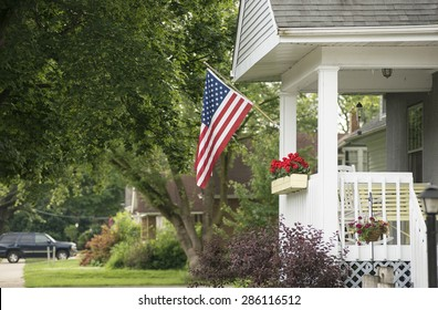 An American home proudly displaying their flag for a patriotic holiday.