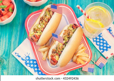 American hot dog with pickles, fried onions, ketchup, mustard and Lemonade at a Picnic for 4th of July