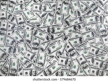 American hundred dollar bills. Fake money as background. One hundred dollars heap. Top view.