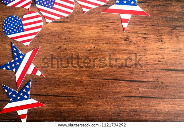 American Independence day background with blue, white and red mixed stars and hearts. Celebration of American independence day, the 4th of July (the Fourth of July). Holiday concept. With copy space.