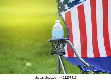 American lawn chair with drink during summer, backyard relaxation.