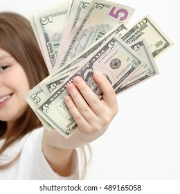 American little girl and dollars