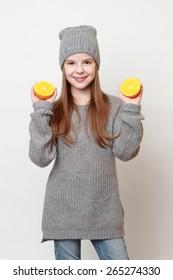 American little girl holding citrus