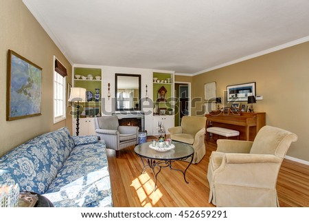 American Living Room Interior With Piano And Hardwood Floor. Furnished With  Glass Top Coffee Table