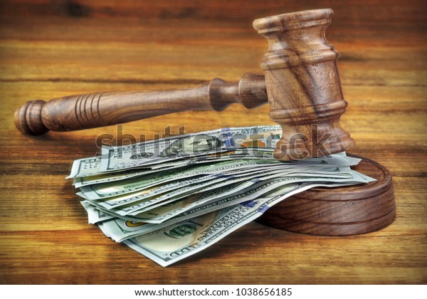 American Money Cash And Auctioneers Or Judges Gavel Or Hammer On Wooden Courtroom Bench Or Auctioneer Table. Wood Background. Law, Monetary, Auction Bidding, Bankruptcy, Bail, Tax Evasion Concept