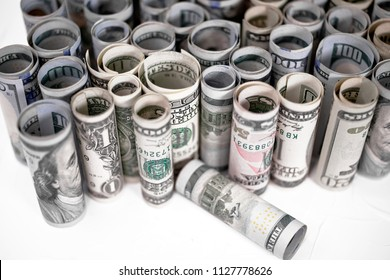 American money of dollar bills of different denominations arranged in rows as a symbol of the power of money able to perform protection for the owner in the event of economic instability