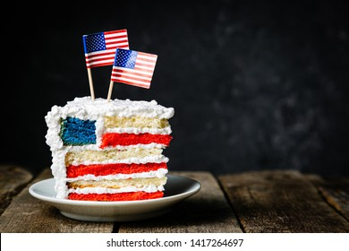 American national holidays concept - 4th of July, Memorial Day, Labour Day. Layered spounge cake in USA flag colours, rustic background, copy space