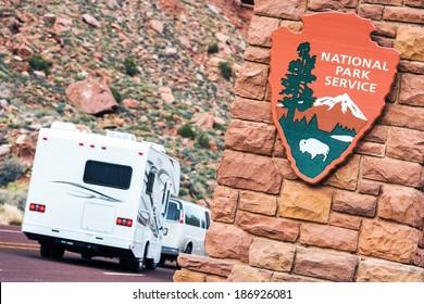 American National Parks RV Journey. National Park Service Shield. Zion National Park Entrance.