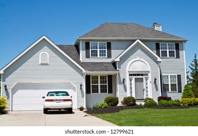 An American Ohio suburban home - neat and tidy.  One car in the driveway.