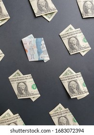 american one dollar bills and colombian banknote of 2000 pesos on the black background