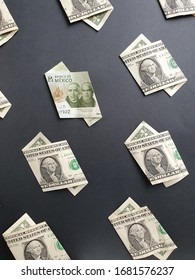american one dollar bills and mexican banknote of 200 pesos on the black background