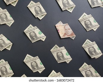 american one dollar bills and peruvian banknote of twenty soles on the black background
