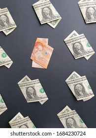 american one dollar bills and philippine banknote of twenty pesos on the black background