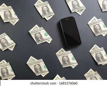 american one dollar bills and smartphone on the black background