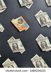 american one dollar bills and swiss banknote of ten francs on the black background