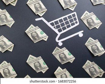 american one dollar bills and white shopping cart on the black background