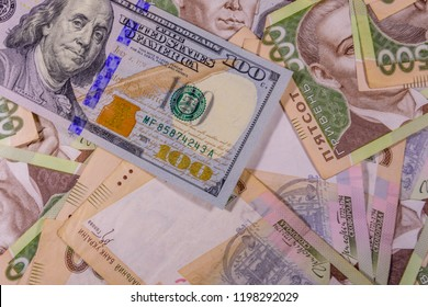 American one hundred dollars banknote on many ukrainian hryvnas