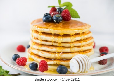 American pancakes with fresh berries and honey