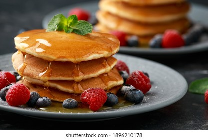 American pancakes with fresh blueberry, raspberry and honey. Healthy morning breakfast