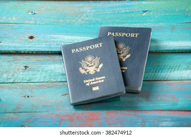American passports on a distressed blue wood background