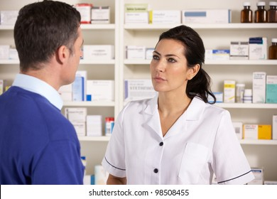 American pharmacist talking to man in pharmacy