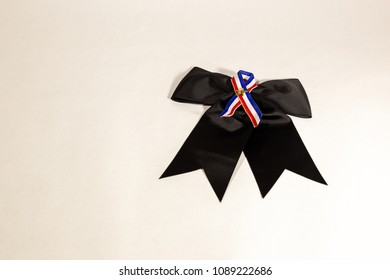 American pin on black ribbon