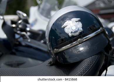 An American police helmet on the saddle of a motorcycle.