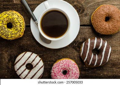 American police officer morning, donuts, juice, fresh black coffee and his gun