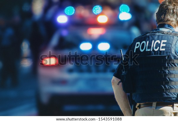 American policeman and police car in the background