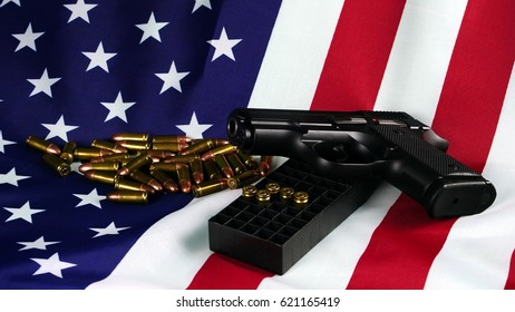 American power. The bullets and a gun on flag of United States. 9mm bullets preparing to shoot and protection.
