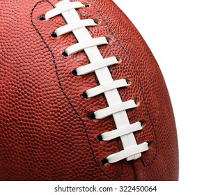 American professional football extreme close up on laces against white background