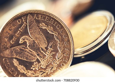 American Quarter Dollar Coin and Other Collectible Coins in the Background.