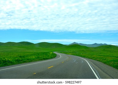 American road California blue sky and grass