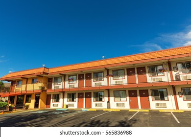 American road motel with blue sky on background.