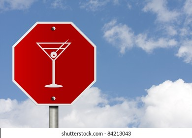 An American road stop sign with sky background and copy space for your message, Stop drinking and driving,
